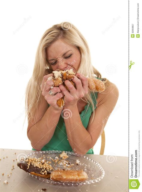 Woman Stuffing Doughnuts Onto Mouth Stock Image - Image