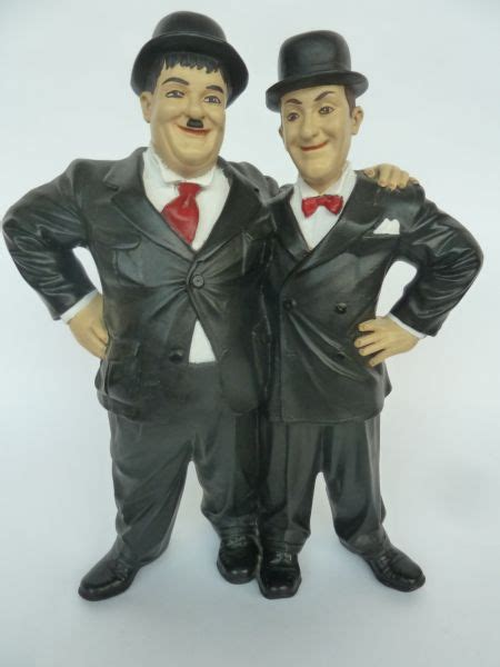 A Laurel and Hardy wooden painted figurine[Lot 319